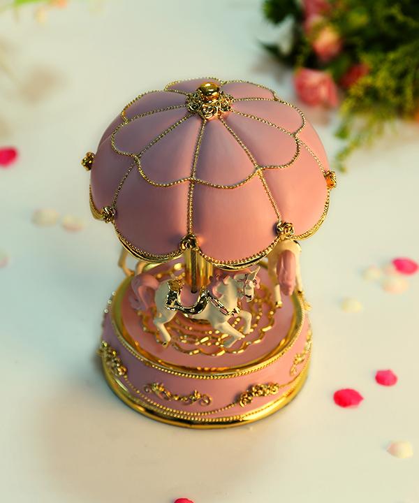 粉红金色花朵伞旋转木马音乐盒